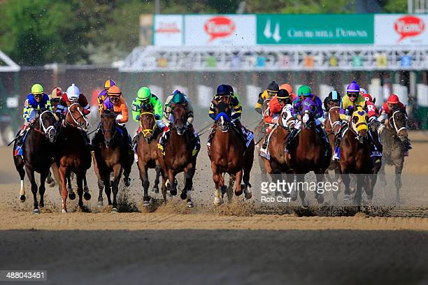 The field comes out of the starter's gate to start the 140th running of the Kentucky Derby at Churchill Downs on May 3 2014 in Louisville Kentucky