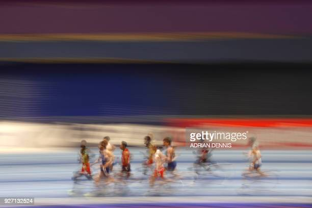 The field compete in the men's 1,500m final at the 2018 IAAF World Indoor Athletics Championships at the Arena in Birmingham on March 4, 2018. / AFP...
