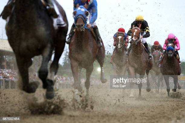 The field crosses the finish line during the 142nd Preakness Stakes at Pimlico Race Course on May 20 2017 in Baltimore Maryland