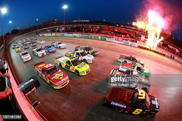 The field does a fourwide military salute prior to the start of the NASCAR Camping World Truck Series Eldora Dirt Derby at Eldora Speedway on July 18...