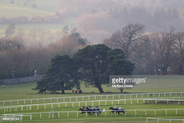 The field for the Competent Roofer Standard Open National Hunt Flat Race heads into the finishing straight at Chepstow Racecourse on March 23 2017 in...