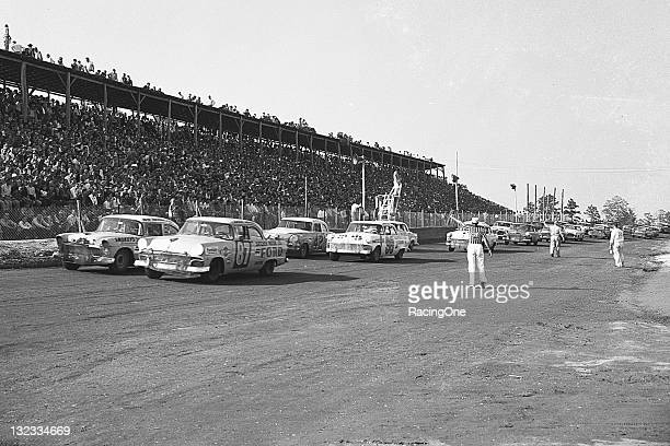 The field gets the one lap to go signal prior to the start of a NASCAR Cup race at North Wilkesboro Speedway Eventual winner Buck Baker in a Ford has...