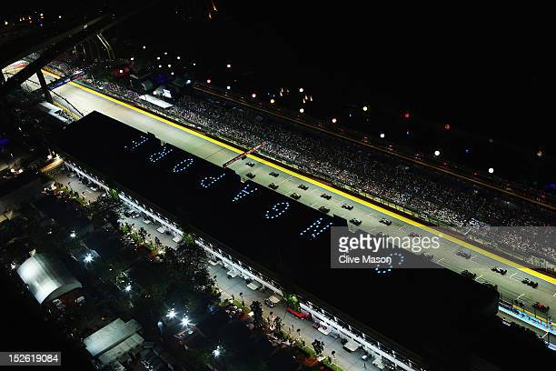 The field gets underway at the start of the Singapore Formula One Grand Prix at the Marina Bay Street Circuit on September 23 2012 in Singapore...
