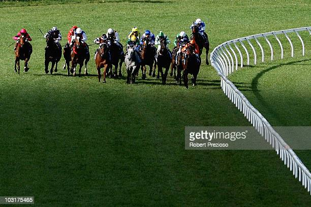 The field head down the straight in race Three Pin Win For Epilepsy Handicap during Bletchingly stakes day at Caulfield Racecourse on July 31 2010 in...
