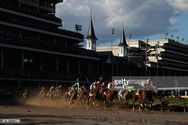 The field heads into the first turn during the 143rd running of the Kentucky Derby at Churchill Downs on May 6 2017 in Louisville Kentucky