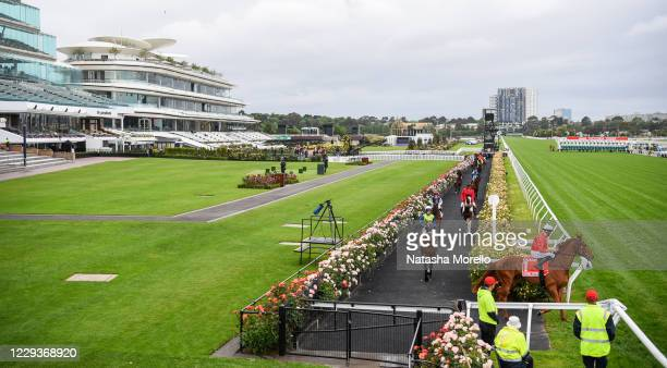 The field heads out to the barriers before the AAMI Victoria Derby at Flemington Racecourse on October 31, 2020 in Flemington, Australia.