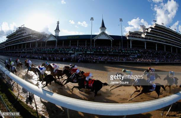 The field heads to the first turn during the 143rd running of the Kentucky Derby at Churchill Downs on May 6 2017 in Louisville Kentucky
