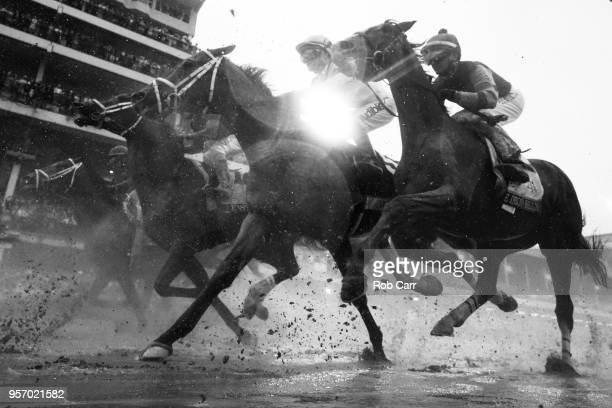 The field heads toward the first turn during the 144th running of the Kentucky Derby at Churchill Downs on May 5 2018 in Louisville Kentucky