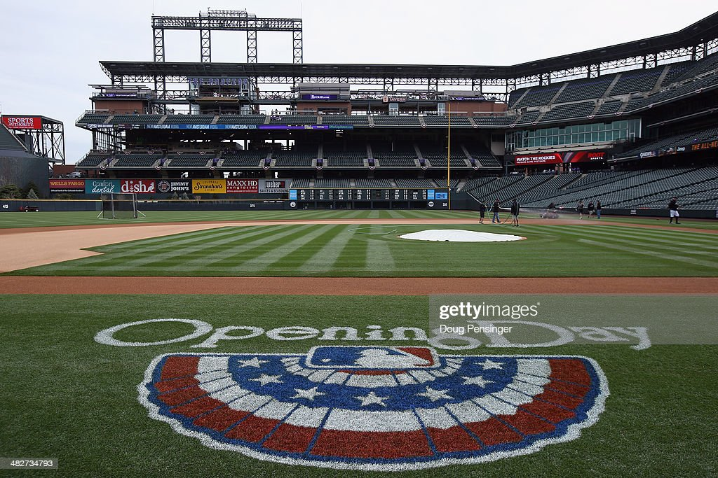 The field is prepared as the Arizona Diamondbacks face the Colorado Rockies during the home opener at Coors Field on April 4, 2014 in Denver, Colorado.