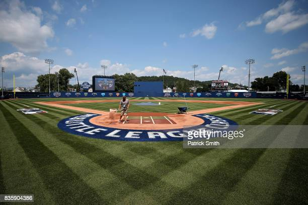 The field is prepared before the St Louis Cardinals play the Pittsburgh Pirates in the inaugural MLB Little League Classic at BBT Ballpark at...