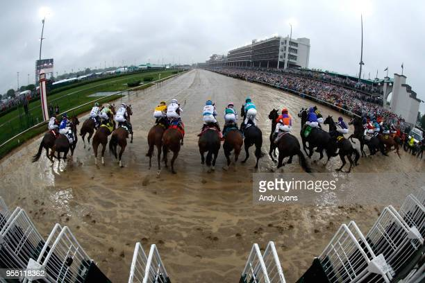 The field leaves the gate at the start of the 144th running of the Kentucky Derby at Churchill Downs on May 5 2018 in Louisville Kentucky