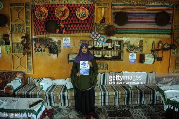 The field manager of the Somali NGO 'Save Somali Women and Children' Farhiya Abdi Samad holds a message 'Save Somali Women and children' as women...