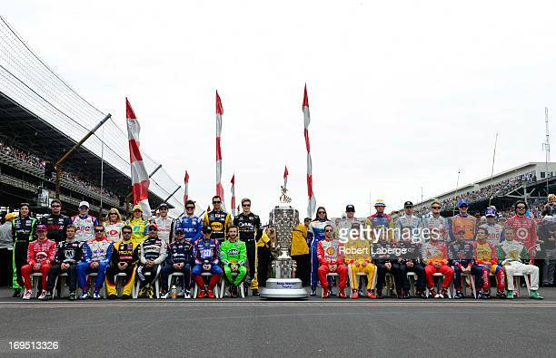 The field of drivers pose for a group photo on the grid during the IZOD IndyCar Series 97th running of the Indianpolis 500 mile race at the...