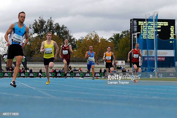 The field of the mens 400m heat 3 run down the back straight during the 92nd Australian Athletics Championships at Olympic Park on April 3 2014 in...