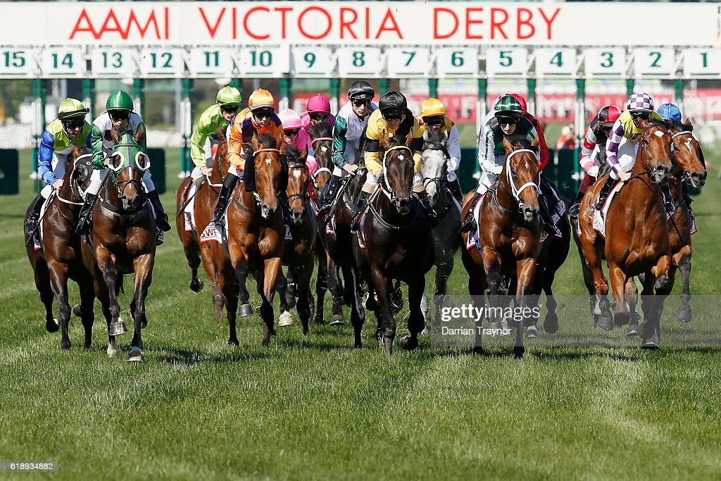 The field pass the post for the first time in race 7, the AAMI Victoria Derby on Derby Day at Flemington Racecourse on October 29, 2016 in Melbourne, Australia.
