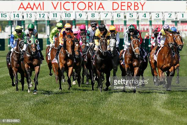 The field pass the post for the first time in race 7 the AAMI Victoria Derby on Derby Day at Flemington Racecourse on October 29 2016 in Melbourne...
