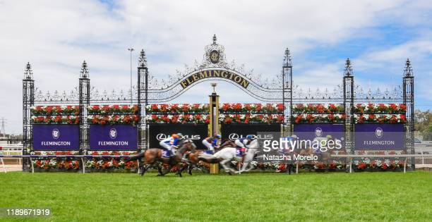 The field pass the post for the first time in the Christmas Carols Handicap at Flemington Racecourse on December 21, 2019 in Flemington, Australia.