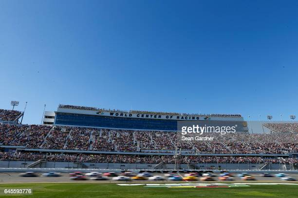 The field passes the green flag at the start of the 59th Annual DAYTONA 500 at Daytona International Speedway on February 26 2017 in Daytona Beach...