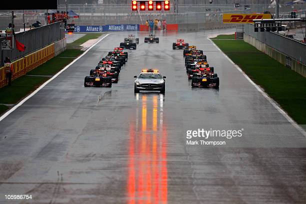The field prepares to start under the safety car as the start of the race is delayed due to bad weather during the Korean Formula One Grand Prix at...