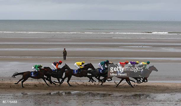 The field races along the beach during the second race at the Laytown beach racetrack on September 11 2008 in Laytown Ireland