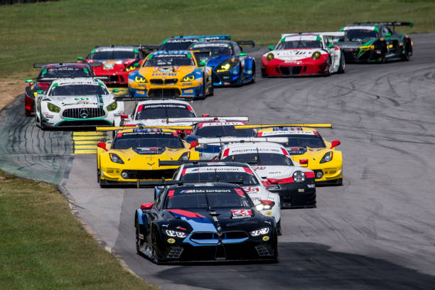 The Field Races Through A Turn At Start Of Michelin Gt Challenge Imsa Weathertech