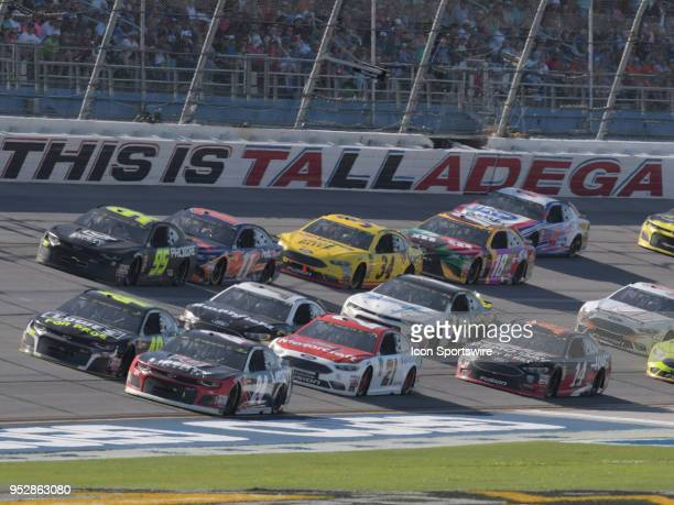 The field races through the trioval through during the Monster Energy Cup Series 49th Annual Geico 500 on April 29 at Talladega Superspeedway in...