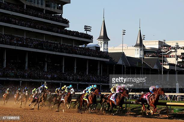 The field races through turn one at the start of the 141st running of the Kentucky Derby at Churchill Downs on May 2 2015 in Louisville Kentucky