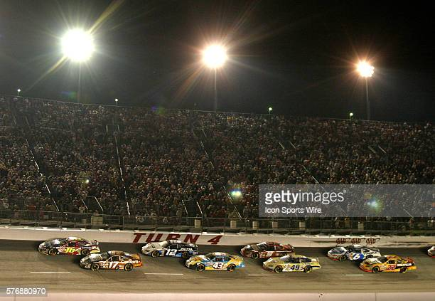 The field rolls through turn 4 during a restart in the Dodge Charger 500 at Darlington Raceway in Darlington, SC on Saturday, May 7, 2005.