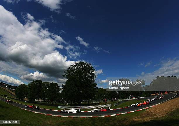 The field rounds Druids Hill Bend during the Cooper Tires British Formula 3 Championship race at the Brands Hatch Circuit on June 24, 2012 near...