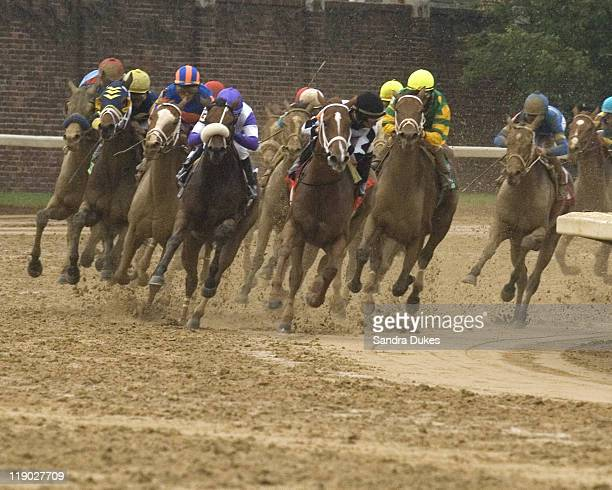 The field rounds the 4th turn onto the front stretch with eventual winner Rags to Riches running wide and 3rd from the left in the 133rd running of...