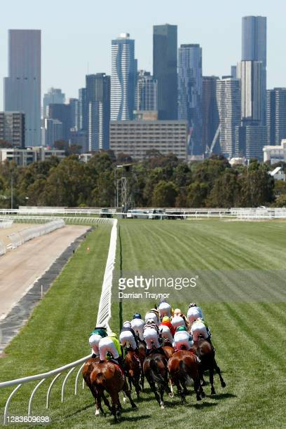 The field run down the back straight in race 4 The Macca's Run during 2020 Lexus Melbourne Cup Day at Flemington Racecourse on November 03, 2020 in...