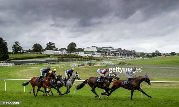 The field take the bottom bend in the Owners Group Makes A Great Gift Handicap at Chepstow Racecourse on July 03, 2020 in Chepstow, England.