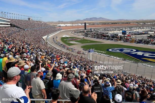 The field takes the green flag as fans cheer at the start of the Kobalt 400 Monster Energy NASCAR Cup Series race on March 12 2017 at Las Vegas Motor...