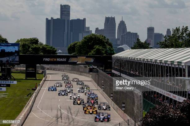 The field takes the green flag at the start of the Detroit Grand Prix Sunday IndyCar race at Belle Isle Park on June 4 2017 in Detroit Michigan