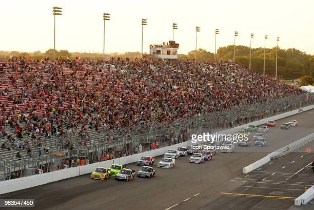 The field works their way down the front stretch during the NASCAR Camping World Truck Series Villa Lighting delivers the Eaton 200 presented by CK...