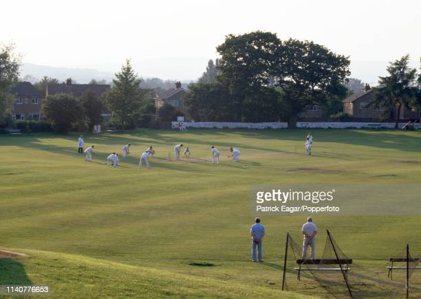 The fielding team put pressure on the batsman in a village cricket match at Menston Yorkshire in 1987 All ten fielders are gathered around the batsman