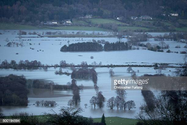 The fields around Keswick remain flooded after torrential rain from Storm Desmond on December 6 2015 in Keswick England Storm Desmond has brought...