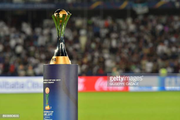 The FIFA Club World Cup trophy is seen on the pitch ahead of the FIFA Club World Cup 2017 final football match between Real Madrid and Gremio FBPA at...