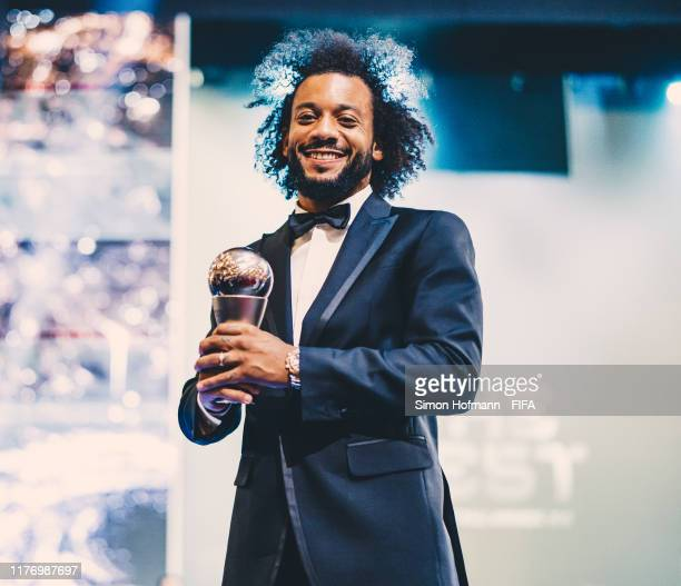 The FIFA FIFPro Men's World11 Award Winner Marcelo of Real Madrid and Brazil poses with his trophy during The Best FIFA Football Awards 2019 at...