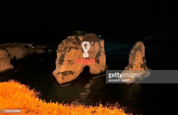 The Fifa World Cup Qatar 2022 logo is projected on the famous Pigon's Rock landmark in the Lebanese capital Beirut on September 3, 2019.