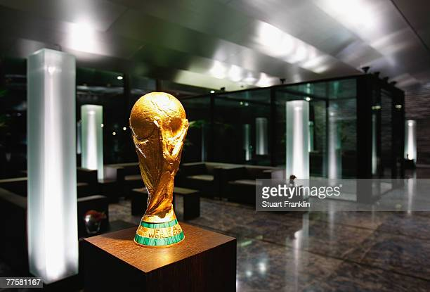 The FIFA World Cup trophy is displayed in the reception of the FIFA headquarters during the FIFA Executive Committee announcement for the host venue...