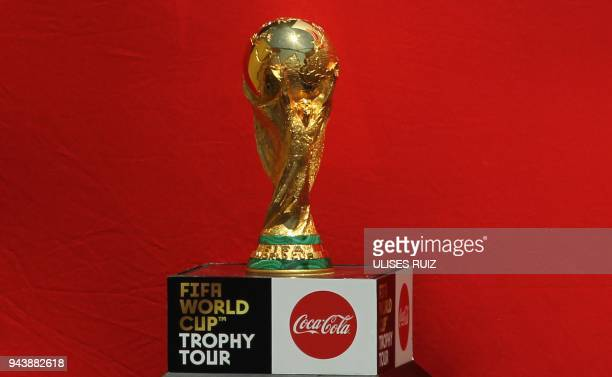 The FIFA World Cup trophy is displayed upon arrival at Miguel Hidalgo International Airport in Guadalajara Jalisco State Mexico on April 9 2018 as...