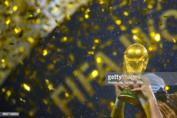 The FIFA World Cup Trophy is lifted during the 2018 FIFA World Cup Russia Final between France and Croatia at Luzhniki Stadium on July 15, 2018 in...