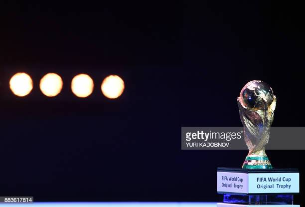 TOPSHOT The FIFA World Cup trophy is placed on stage ahead of the 2018 FIFA World Cup football tournament final draw at the State Kremlin Palace in...