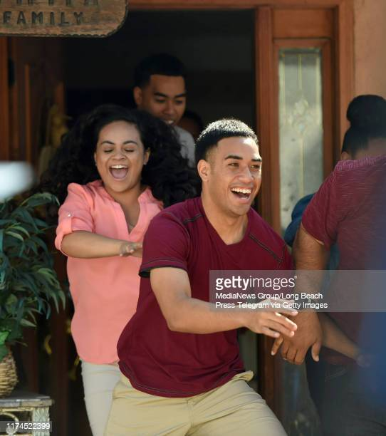 The Fifita family runs outside after a surprise from the cast and crew of Extreme Makeover Home Edition in Hawthorne on Thursday September 12 2019...