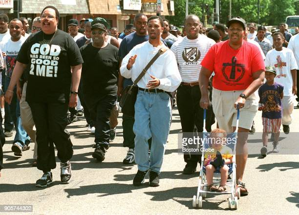 The fifth annual Father's Day March held by the Boston TenPoint Coalition heads down Blue Hill Avenue in the Dorchester neighborhood of Boston as...
