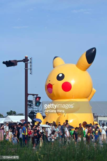 """the fifth annual """"pikachu outbreak"""" in yokohama (2018) - interracial cartoon stock photos and pictures"""
