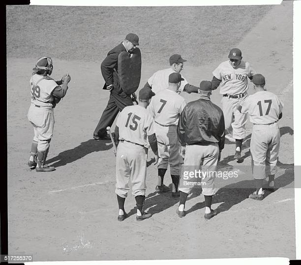 The fifth man in World Series history to hit a Grand Slam Homer Yankee catcher yogi Berra crosses home plate after his classic sock in the second...