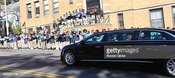 The fifth through eighth graders at the Brooke Charter School's Roslindale campus greet the funeral procession for late Boston mayor Thomas M Menino