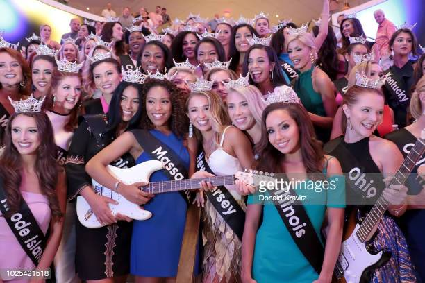 The fifty-one Miss America 2019 candidates pose for a photograph on the steps before the Ribbon Cutting at the new Rock Spa at Hard Rock Hotel &...